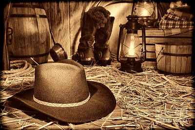 Photograph - Black Cowboy Hat In An Old Barn by American West Legend By Olivier Le Queinec