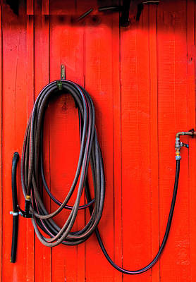 Photograph - Black Hose Red Wall by Tom Singleton