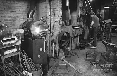 Photograph - Blacksmith Working by Jim Corwin