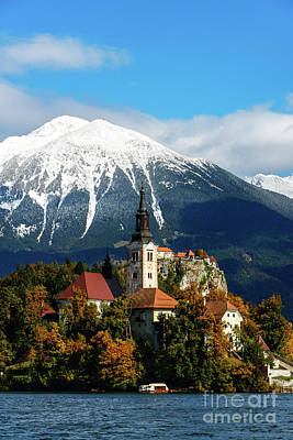 Photograph - Bled Lake With Snow On The Mountains In Autumn by IPics Photography