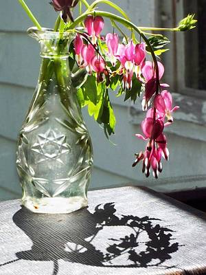 Bleeding Hearts In A Vinegar Bottle Art Print by Joy Nichols