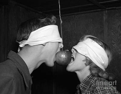 Blindfolded Teenagers Try For Apple Art Print by H. Armstrong Roberts/ClassicStock