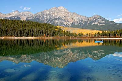 Blue Canoe On Patricia Lake Art Print by Larry Ricker