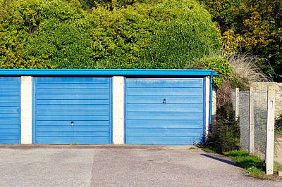 Blue Garage Doors Art Print by Tom Gowanlock