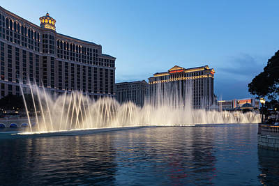 Photograph - Blue Hour Fountains - Bellagio And Caesars Palace Las Vegas by Georgia Mizuleva
