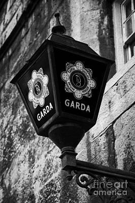 Blue Lamp Above Station Door For The Garda Siochana Na Heireann The Irish Police Force In Dublin Art Print by Joe Fox