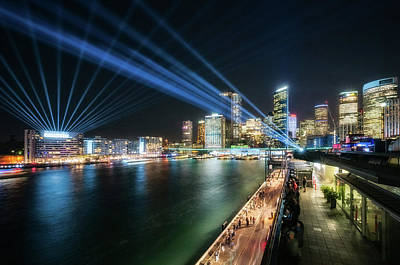 Photograph - Blue Lasers Cross The Sky At Vivid Sydney At Night by Daniela Constantinescu