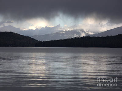 Blue Sky Through Dark Clouds Print by Carol Groenen