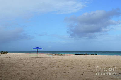 Photograph - Blue Umbrella And Empty Chair On A Beach In Aruba by DejaVu Designs