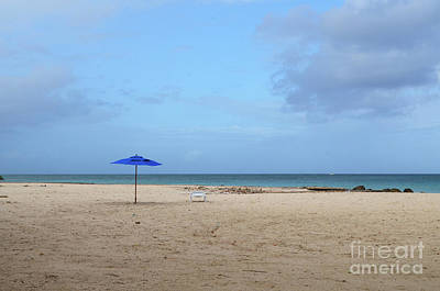 Photograph - Blue Umbrellas Standing Alone On A White Sand Beach by DejaVu Designs