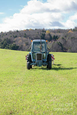 Photograph - Blue Vintage Tractor In A Pasture by Edward Fielding