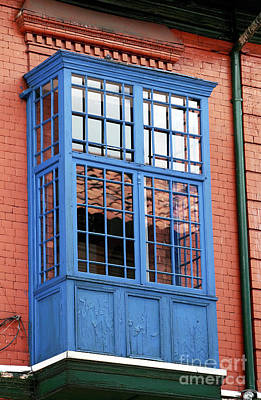 Blue Window In Bogota Print by John Rizzuto