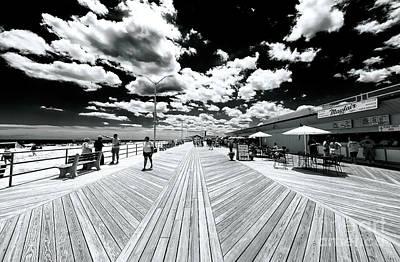 Photograph - Boardwalk Clouds 2007 by John Rizzuto