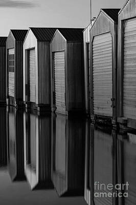 Photograph - Boat Houses In Rows With Reflections  by Jim Corwin