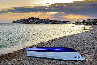 Photograph - Boat On The Beach At Sunset In Primosten, Croatia by Global Light Photography - Nicole Leffer