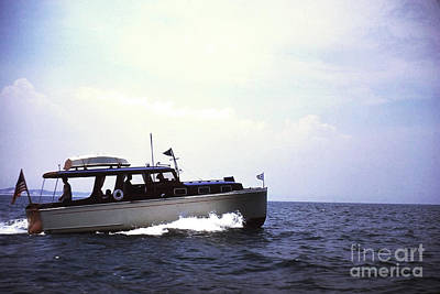 Photograph - Boat On The Lake by Larry Ward