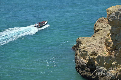 Boat Passing By The Cliffs In Lagoa Art Print by Angelo DeVal