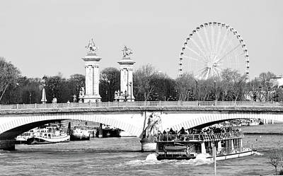 Photograph - Boat Passing Under Pont Des Invalides With Pont Alexandre Columns And Roue De Paris Black And White by Shawn O'Brien