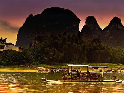 Giuseppe Cristiano - Boat sailing in purple sunset-China Guilin scenery Lijiang River in Yangshuo by Artto Pan