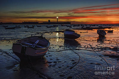 Clouds Rights Managed Images - Boats at Dusk Royalty-Free Image by Pablo Avanzini