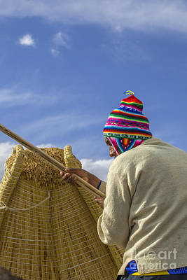 Photograph - Boatsman On Reed Boat In Peru by Patricia Hofmeester