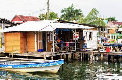 Photograph - Bocas Town Lunch At Bocas Del Toro by John Rizzuto
