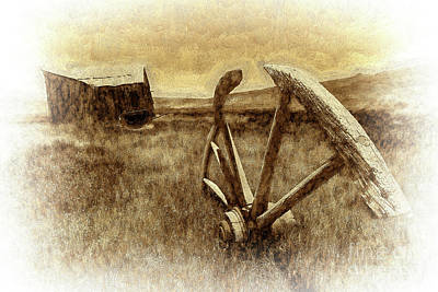 Photograph - Bodie California Ghost Town Buried Wagon Wheel Bw by Dan Carmichael