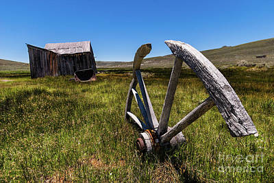 Photograph - Bodie California Ghost Town Buried Wagon Wheel by Dan Carmichael