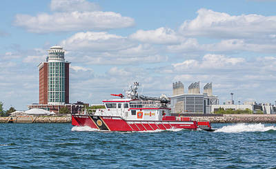 Photograph - Boston Fire Rescue Boat Passing Logan Airport by Brian MacLean