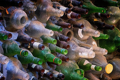 Photograph - Bottles And Cement Wall by Tom Singleton