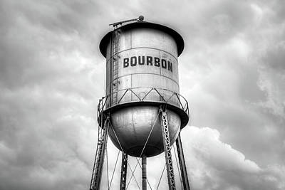 Photograph - Bourbon Whiskey Water Tower And Cloudy Skies - Monochrome by Gregory Ballos