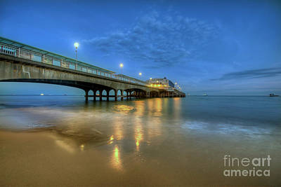 Print featuring the photograph Bournemouth Pier Blue Hour by Yhun Suarez