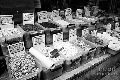 boxes of exotic chinese ingredients outside market in chinatown New York City USA Art Print