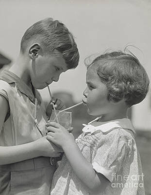 Photograph - Boy And Girl Sharing A Drink, C. 1930s by H. Armstrong Roberts/ClassicStock