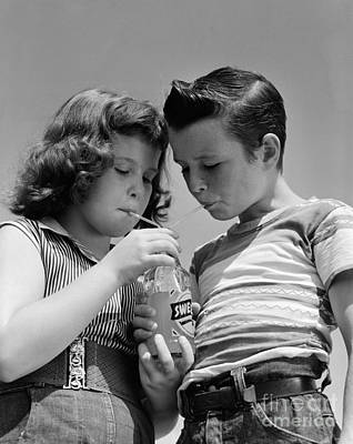 Photograph - Boy And Girl Sharing A Soda, C.1950s by H. Armstrong Roberts/ClassicStock