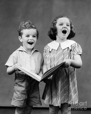 Song Book Photograph - Boy And Girl Singing, 1930 by H. Armstrong Roberts/ClassicStock