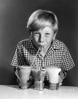 Strawberry Milkshake Photograph - Boy Drinking Three Shakes At Once by Debrocke/ClassicStock