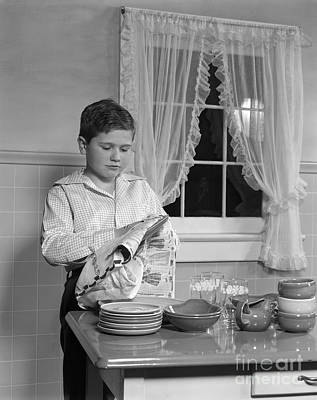 Towels Drying Photograph - Boy Drying Dishes, C.1950s by H. Armstrong Roberts/ClassicStock
