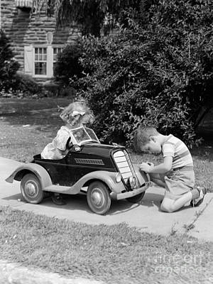 Boy Fixing Girls Headlight, C.1940-30s Art Print by H. Armstrong Roberts/ClassicStock