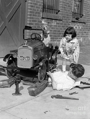 Photograph - Boy Fixing Girls Toy Car, C.1920s by H. Armstrong Roberts/ClassicStock