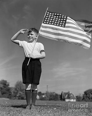 Boy Holding American Flag & Saluting Art Print by H. Armstrong Roberts/ClassicStock