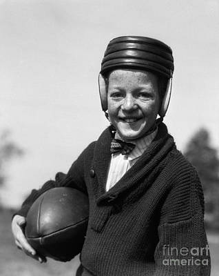 Preteen Photograph - Boy In Old-fashioined Football Gear by H. Armstrong Roberts/ClassicStock