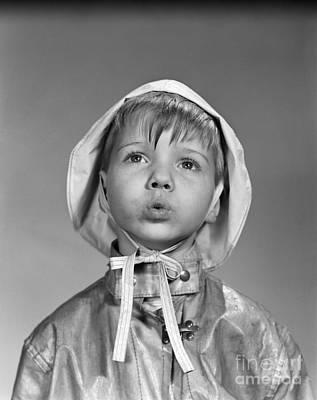Rain Gear Photograph - Boy In Rain Gear, C.1950s by Debrocke/ClassicStock