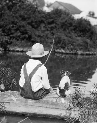 Photograph - Boy In Straw Hat Fishing by H Armstrong Roberts ClassicStock