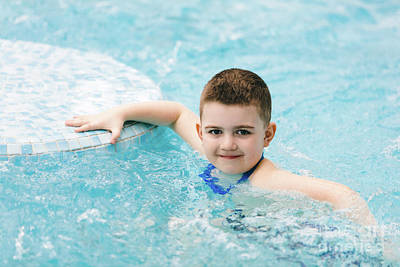Photograph - Boy In Swimming Goggles Relaxing Jacuzzi. by Michal Bednarek