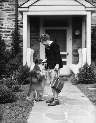 Pet Care Photograph - Boy Leaving For School, C.1930s by H. Armstrong Roberts/ClassicStock