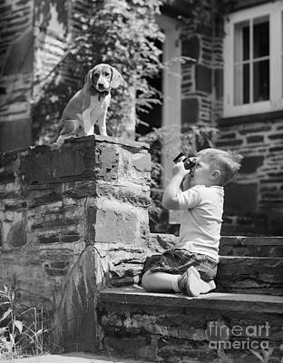 Photograph - Boy Photographing Dog, C.1950s by Debrocke ClassicStock