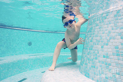 Photograph - Boy Playing In A Swimming Pool With Goggles On by Michal Bednarek