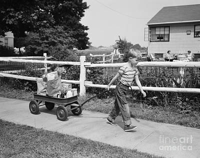 Split Rail Fence Photograph - Boy Pulling Groceries In Wagon, C.1950s by Debrocke/ClassicStock