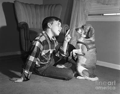 Obey Photograph - Boy Scolding Dog, C.1950s by Debrocke/ClassicStock